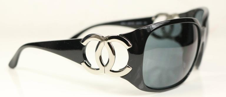 - Chanel black frame with silver tone hinged