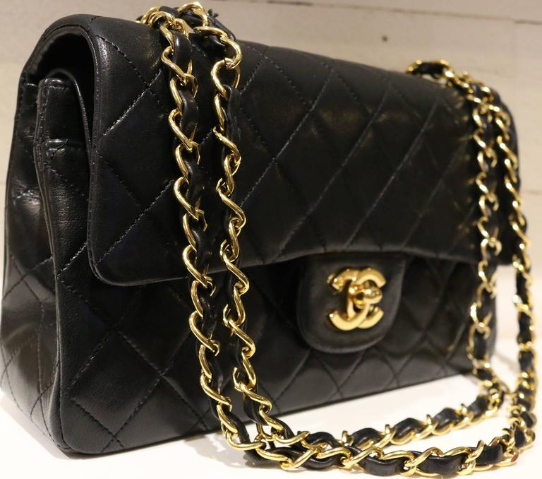 e9fb9e7e355d Vintage 80s Chanel classic black quilted lambskin double flap shoulder bag.  Featuring a gold