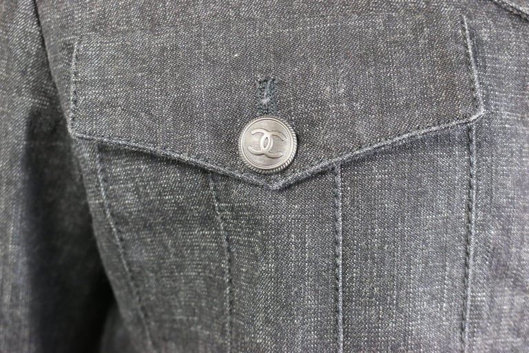 - Chanel grey denim with wool sleeves jacket from 2003 A/W collection. Featuring three black