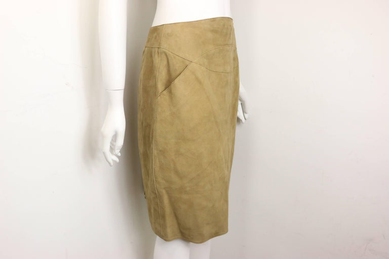 - Vintage Chanel suede lambskin leather knee length pencil skirt from 1999 A/W collection. This sexy and luxury knee length pencil skirt can be worn with many things. The silk lining is always a comfort touch!    - Featuring two side pockets.     -