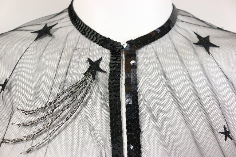 - Vintage Chanel embroidered see through evening dressing gown from 1986 fall collection. Featuring black sequins piping trims, a black embroidered star with silver linings, and a hook closure. A very classic and one of the early years of Karl