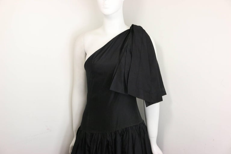 - Vintage Chanel black silk taffeta one shoulder evening gown from 1986 collection. Museum quilty!!!  - Pleated shoulder and bottom part of the dress.   - Two layers.   - Side zipper closure.   - Three hooks closure on the shoulder.