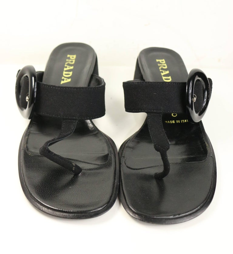 - Vintage 90s Prada black retro style T - shape sandals. Featuring a black vinyl buckle on the side. Looks super retro and chic!   - Made in Italy.   - Size 37.5.