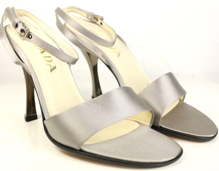 - Vintage 90s Prada silver satin strap slingback sandals heels.   - Made in Italy.   - Size 37.5