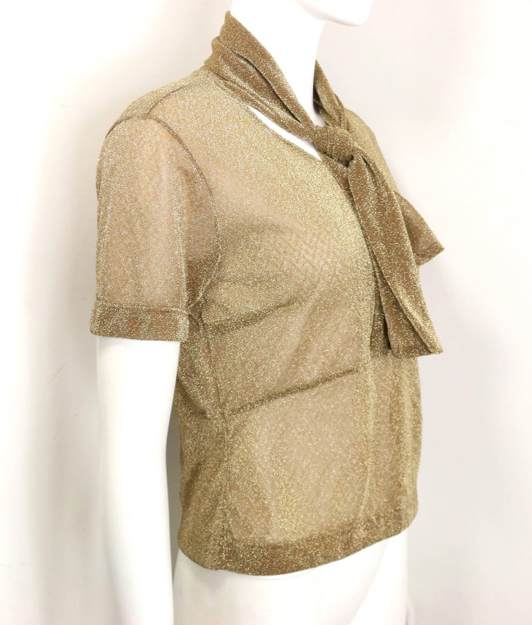 - Vintage 90s Dries Van Noten gold metallic cropped see through short sleeves blouse. Featuring same fabric attached to the neck.  A nice see through top with glitter and shiny all over!     - Made in Belgium.     - Size M.     - 54% Polyester , 46%