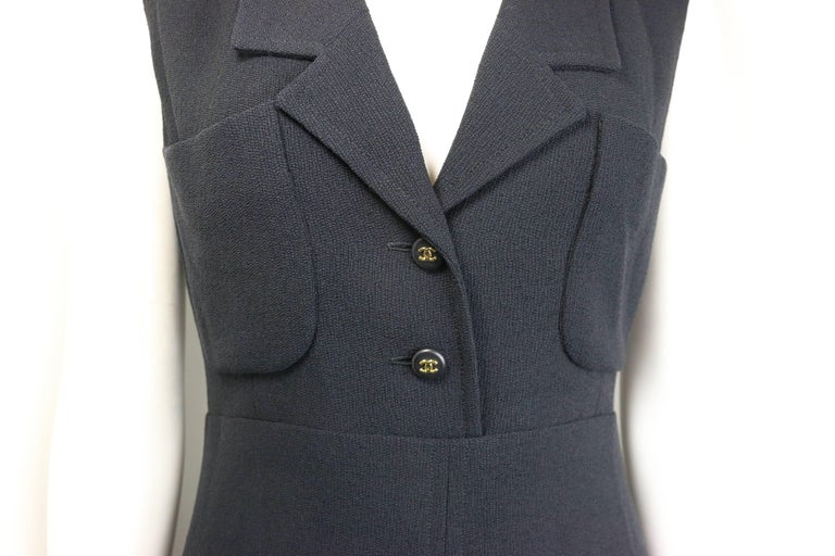 """- Vintage Chanel classic black wool long dress from year 1995 A/W collection. Featuring two front open pockets with two black gold """"CC"""" buttons closure, three buttons black gold """"CC"""" buttons closure at the bottom hem and back zip"""