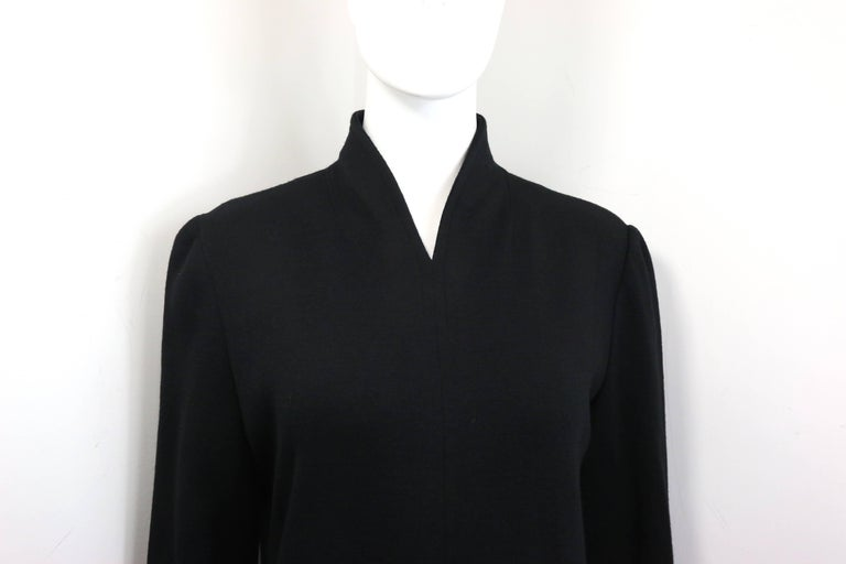 - Vintage 90s Celine black wool long dress.   - V-Shaped Neckline.   - Slit hem in front.  - Back zip closure.   - Size 40.   - Shoulder: 15 inches. Bust: 32 inches. Height: 51 inches. Sleeve: 24 inches.   - 100% Pure wool.   -