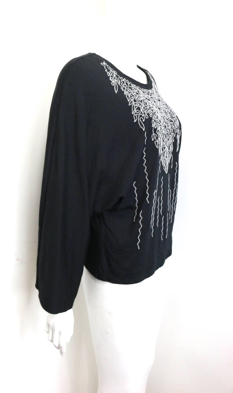 "- Issey Miyake Fete black cotton with silver thread wire embroidered print cocoon long sleeves top. This Fete line of Issey Miyake means colorful women's line that ""draws on the technological innovations of Pleats Please"" (Fête means"