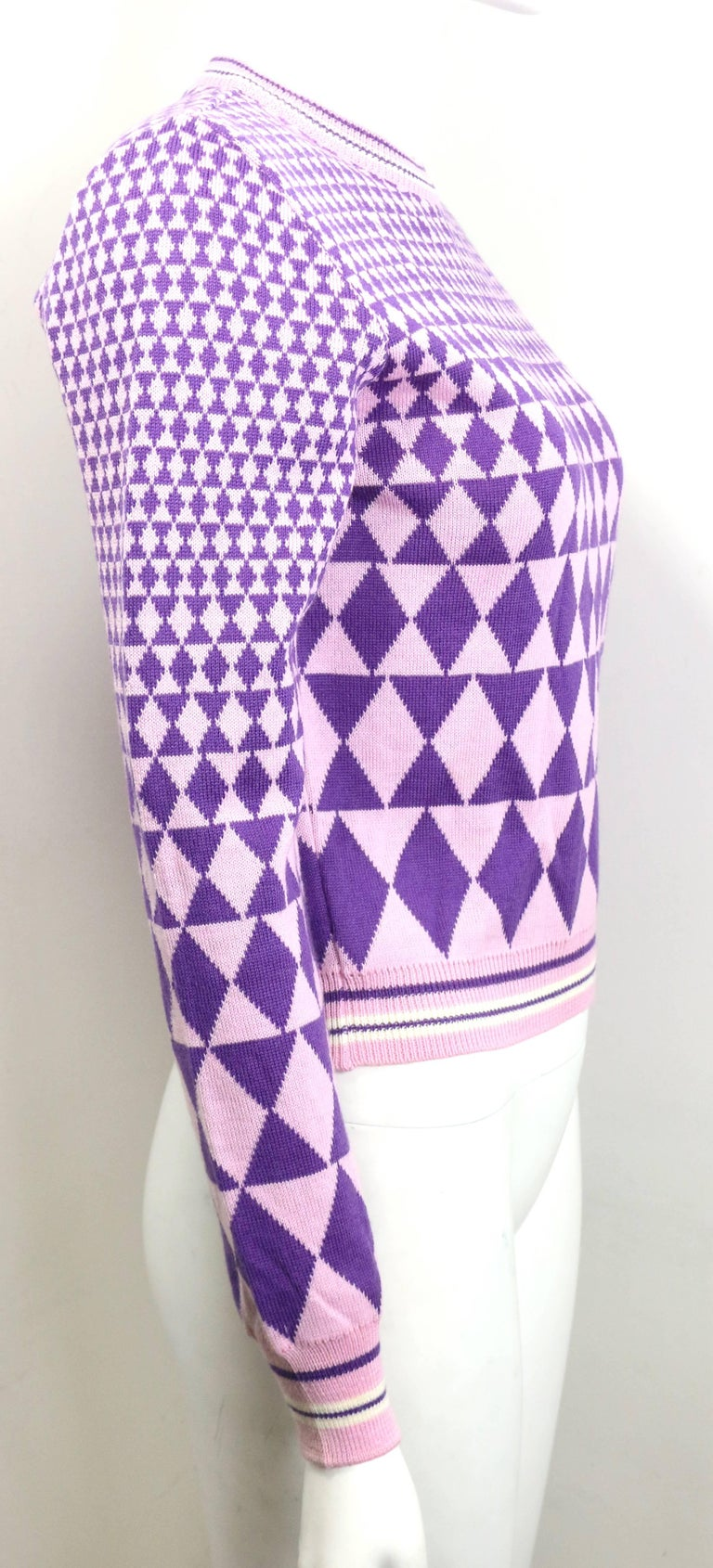 - 90s Gianni Versace Sport geometric pattern purple cropped pullover sweater.       - Ribbed white/purple stripe collar, cuffs and hem.    - Made in Italy.     - 100% Wool.     - Size 40 Italy.     - Shoulder: 14 inches. Sleeve: 23 inches. Bust: 34