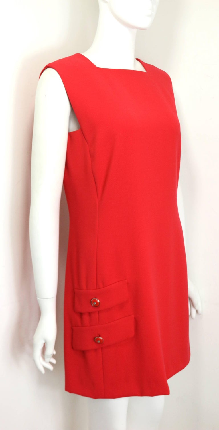 - Vintage Gianni Versace red wool sleeveless dress from 1996 collection.   - Square Neckline.   - Two flap with red leather silver toned