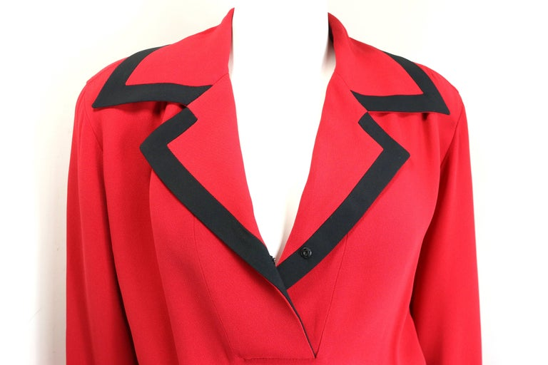 - Vintage 90s Moschino Couture red piping black trim long sleeves dress.   - Collar lapel with snap button fastening.   - Two piping black trim red open front pockets.   - Cuffs button closure. Can flap the sleeves back in order to show the piping