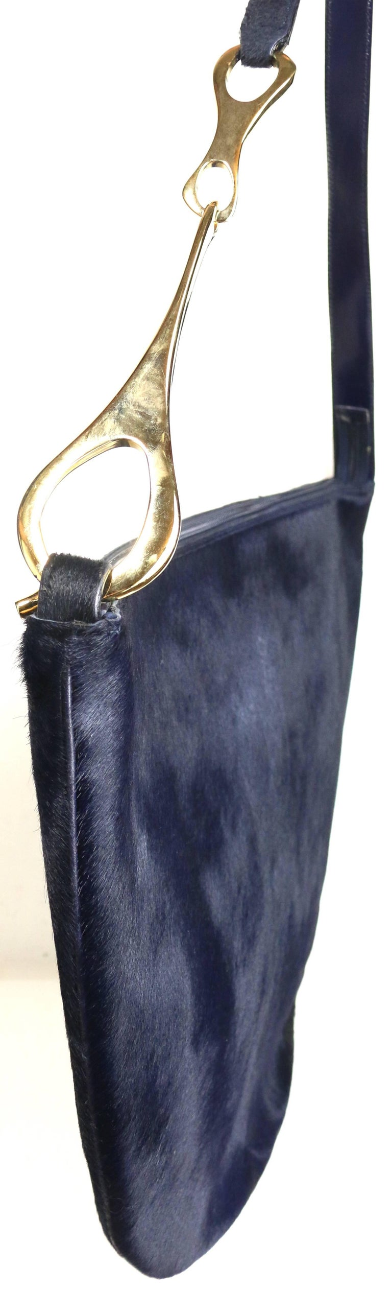 - Gucci by Tom Ford navy pony hair jumbo shoulder bag from Fall 1996 collection.   - Half circle shape.   - The signature Fall 1996 collection gold toned metal buckle shoulder strap.  - Gold toned metal