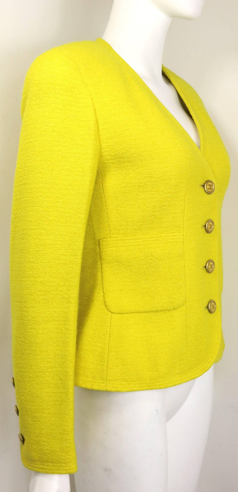- Vintage Chanel yellow wool jacket from 1994 A/W collection.   - V neck with no collar.   - Four front gold toned