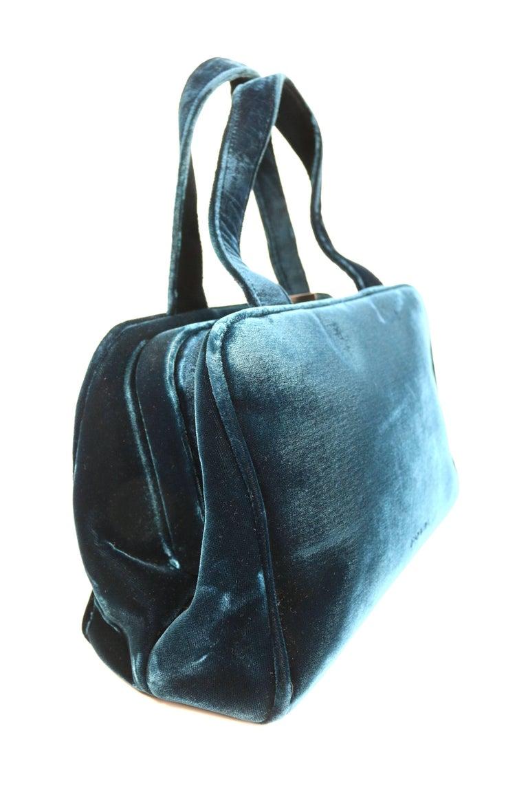 - Vintage 90s Prada blue velvet handbag.   - Rectangle shape.   -