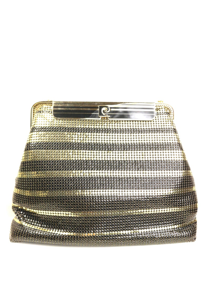 - One of a kind vintage 80s Pierre Cardin black and gold plated stripe sequins shoulder bag/clutch.   - Gold plated with logo flap closure.   - Gold plated shoulder strap.   - Two interior satin open pocket.   - Height: 7 inches. Length: 9 inches.