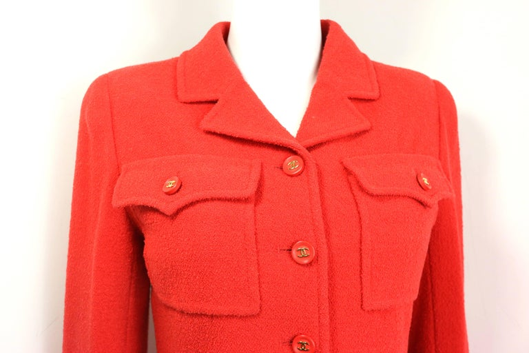 - Vintage Chanel red wool jacket from 1995 A/W collection.   - Two front flap pockets with gold toned