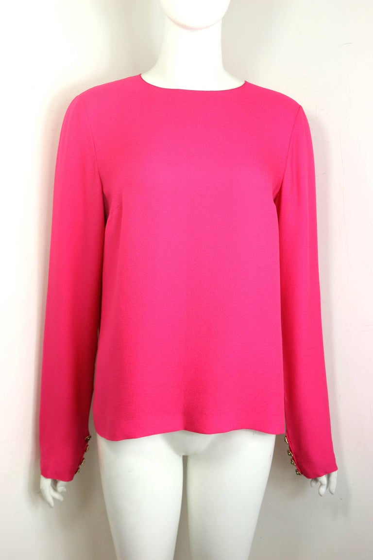 - Chanel fuchsia pink silk shirt.   - Featuring Gripoix buttons closure  at the back and the cuffs.   - Round neck.   - Size 38.   - 100% Silk.