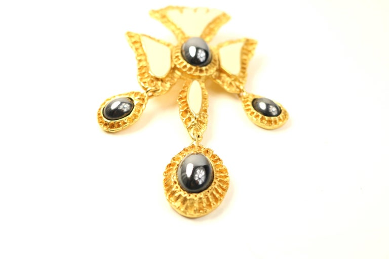 - Vintage 80s Christian Lacroix black and white cross gold toned setting brooch.   - Size : Height: 3.5 inches. Length: 1.5 inches width.