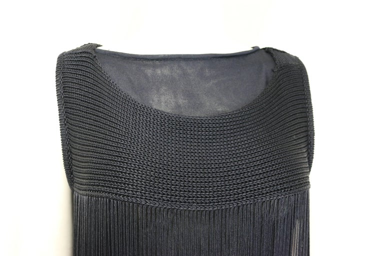 - Jil sander navy knitted with a front fringe dress.   - Featuring a double silk layer inside which you can wear it separately.   - Size 34.
