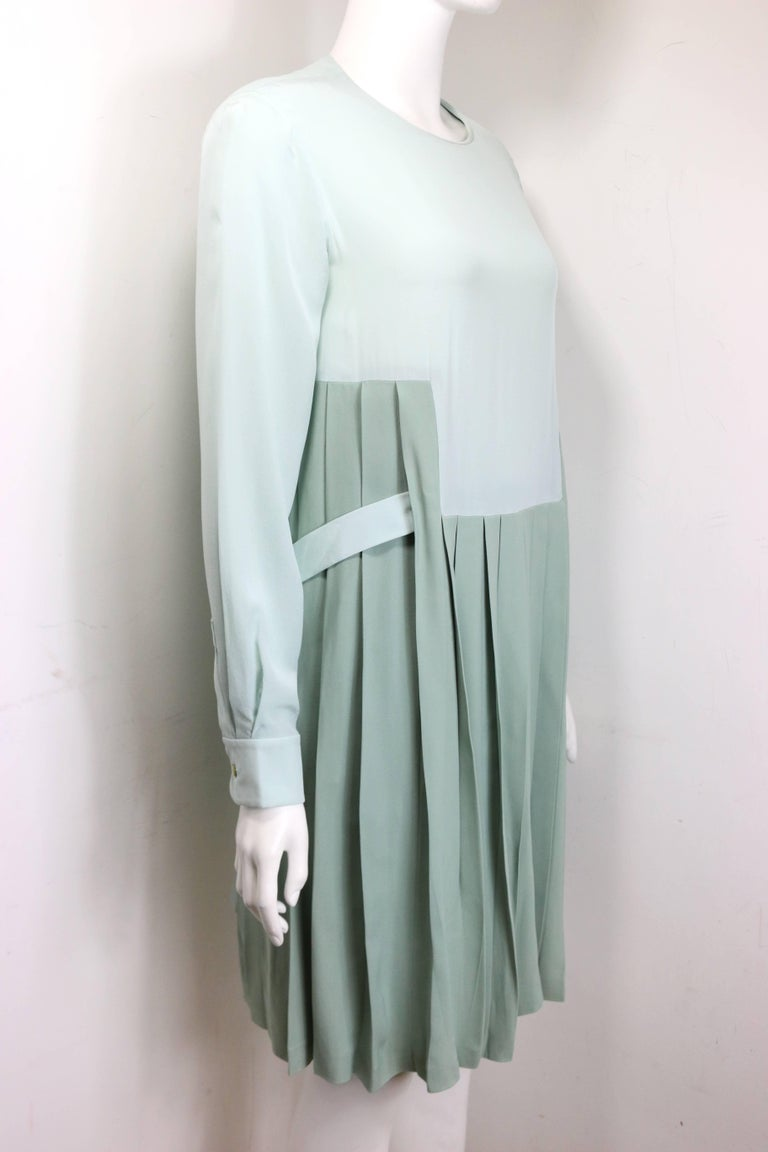 - Chloe green silk two-tone pleated long sleeves dress. Double layer with a white layer underneath.   - There is a belt on the waist with button closure.   - Back