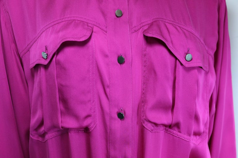 - Lanvin pink silk button front jumpsuit from 2013 collection.   - Two front pockets, front panel, epaulette and cuff with charcoal-toned hardware buttons closure.   - Extra silk fabric that can be tied around the waistline   - Size 36.   - 100%