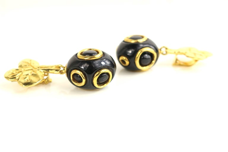 - Vintage 90s Christian Lacroix black and gold-toned hardware clover clip-on earrings.   - Featuring drop black and gold-toned hardware round shape.   - Height: 2.5 inches. (6.4cm). Length: 1 inches (2.5 cm). Diameter: 1 inches (2.5 cm).