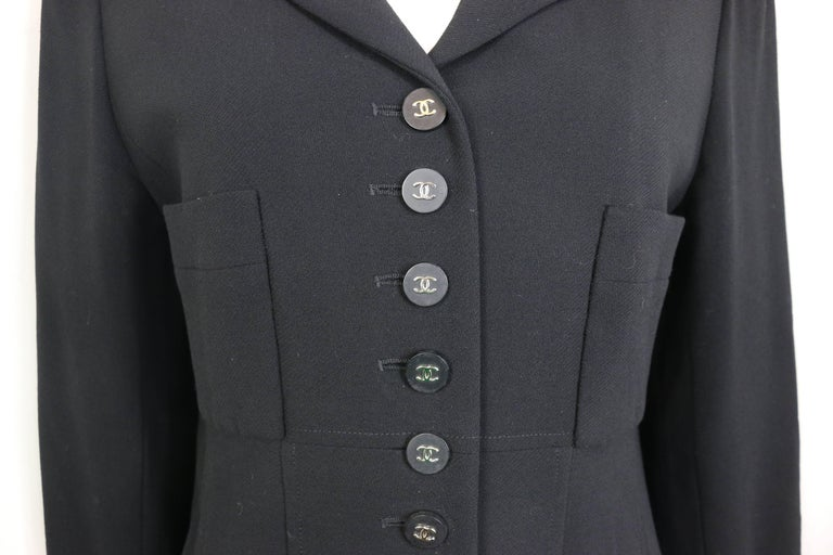 - Vintage Chanel classic black wool jacket from 1996 pre-collection.   - Featuring silver