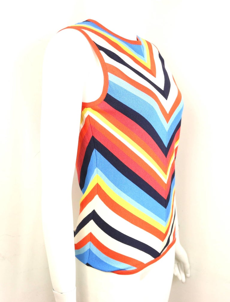 - Celine silk colour blocked chevron pattern sleeveless top.   - Orange ribbed trim on the neck, hem, and underarm.   - Straight cutting.   - Size L.   - Shoulder: 13 inches. Bust: 30 inches. Waist: 30 inches. Height: 23 inches.   - 95% Silk, 5%