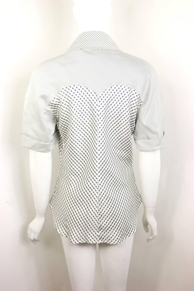 - Vintage 90s Givenchy Couture by Alexander McQueen black and white silk check pattern short sleeves blouse.   - Featuring round shoulder with big pointy V-neck collar.   - The hem is curvy at the front and it is slightly shorter than the back.   -