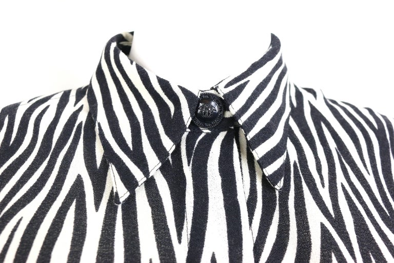 "- Vintage 1996 Gianni Versace Couture black and white wool zebra pattern shirt.   - Featuring black buttons fastening with a top plastic black ""Medusa"" button fastening. One plastic black ""Medusa"" button on each cuff.   - Size 40.   - 85% Wool, 15 %"