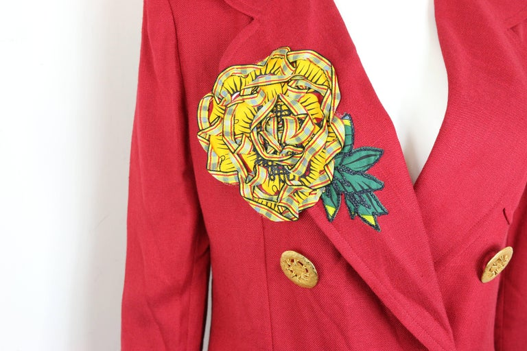 - Vintage 1994 spring Christian Lacroix red double-breasted blazer. It is a rare and collectible item.   - Featuring a yellow ruffle sunflower on the right lapel and three at the back.   - Gold-toned hardware buttons closure.   - Two front open