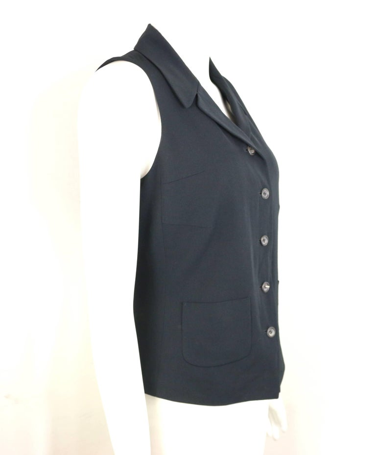 - Vintage 90s Jil Sander black viscose and wool vest.   - Featuring a notch lapel, button closure, and two front open pockets.   - Size 36.   - 52% Viscose, 48% Wool. Lining: 100% Cuppo.