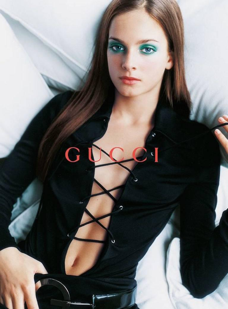 - Vintage 1996 Spring/Summer Tom Ford for Gucci black jersey tunic dress. This dress had been shown in the ad campaign.  Tom Ford is a genius for making women sexy!   - Featuring a pointy collar with deep V- neck with strap tieing across the