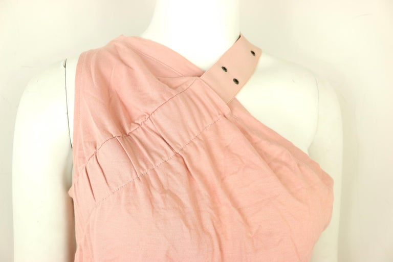 - Vintage 2000s Dior cotton pink tank top.  - Featuring an eyelet strap across the left shoulder to right bust. It has a lower armpit cut on the left side and higher on the right armpit. It's very deconstructed which is the signature design of John
