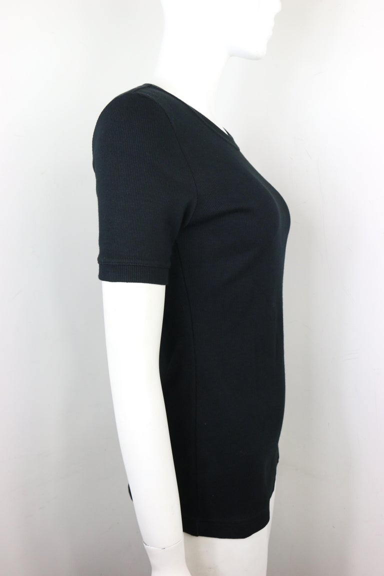 - Vintage Tom Ford for Gucci thick cotton black short sleeves top from 1996 spring collection.   - Featuring Gucci label on the left sleeve.   - Ribbed neck, sleeves, and hem.   - Size L.   - 85% Cotton, 15% Spandex.   - Unworn with original tag.
