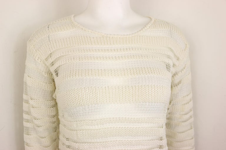 - Vintage 90s Dolce and Gabbana white cotton and silk knitted mesh long sleeves pullover sweater top.   - The throughout horizontal white mesh and knitted pattern are very refined and delicate!   - Size 42.   - 35% Cotton, 35% Silk, 30% Nylon.   -