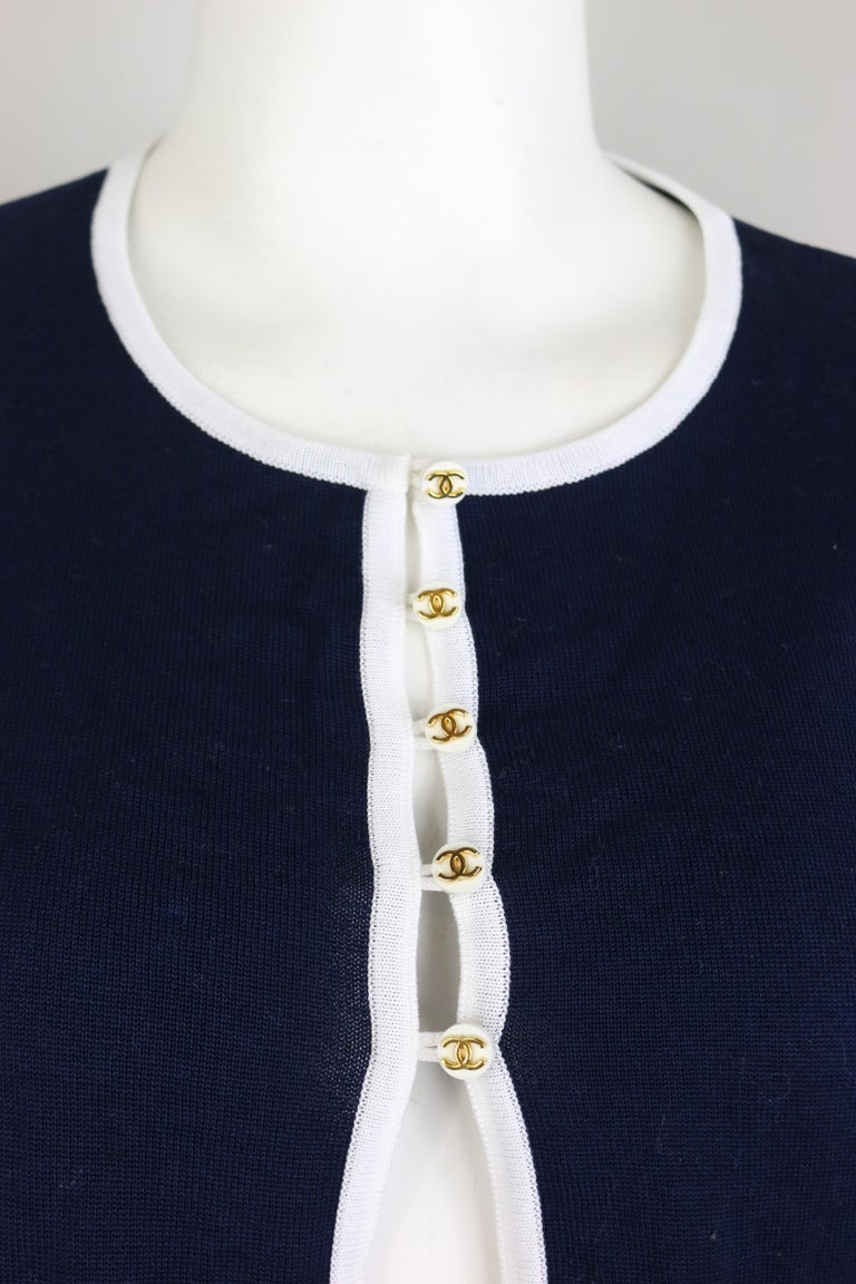 - Vintage Chanel navy with white piping trim cotton knitted cropped short sleeves cardigan top from 1996 spring collection.   - Featuring gold-toned