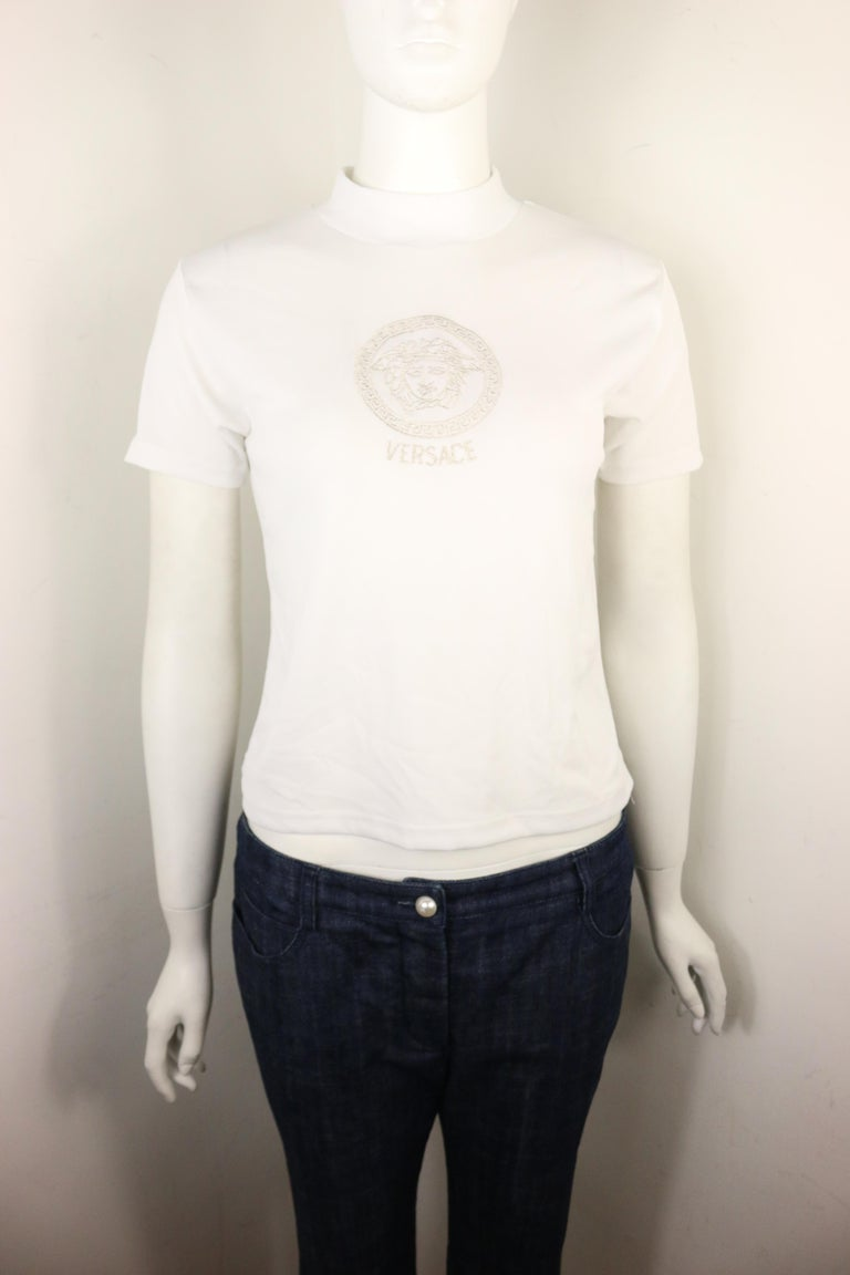 - Vintage 90s Gianni Versace Jeans Couture white cotton mock neck short sleeves cropped top. The cotton is really fine!!!  - Featuring a silver embroidered
