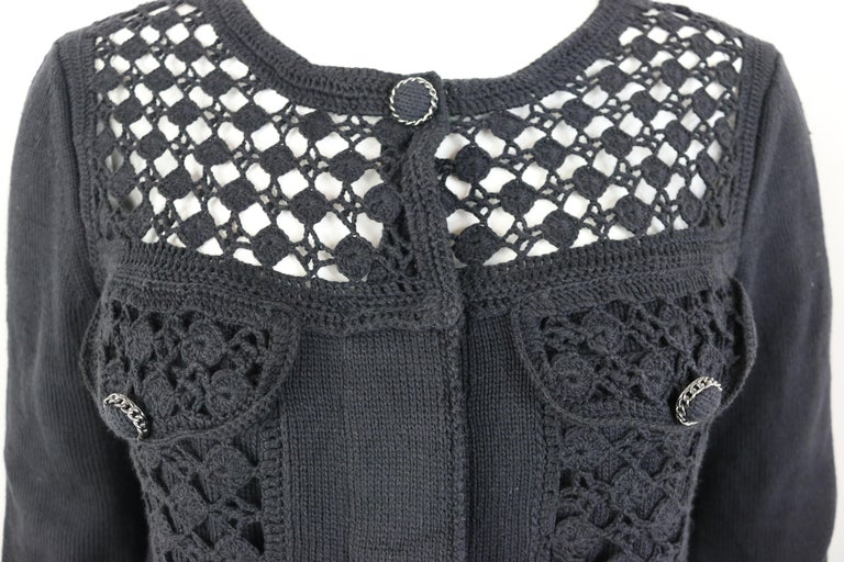 - Chanel black cotton pattern knitted 3/4 sleeves length cardigan from spring 2016 collection.   - Featuring front black knitted button closure on top with mother pearl buttons closure below. Two front flap pockets with knitted buttons closure. Two