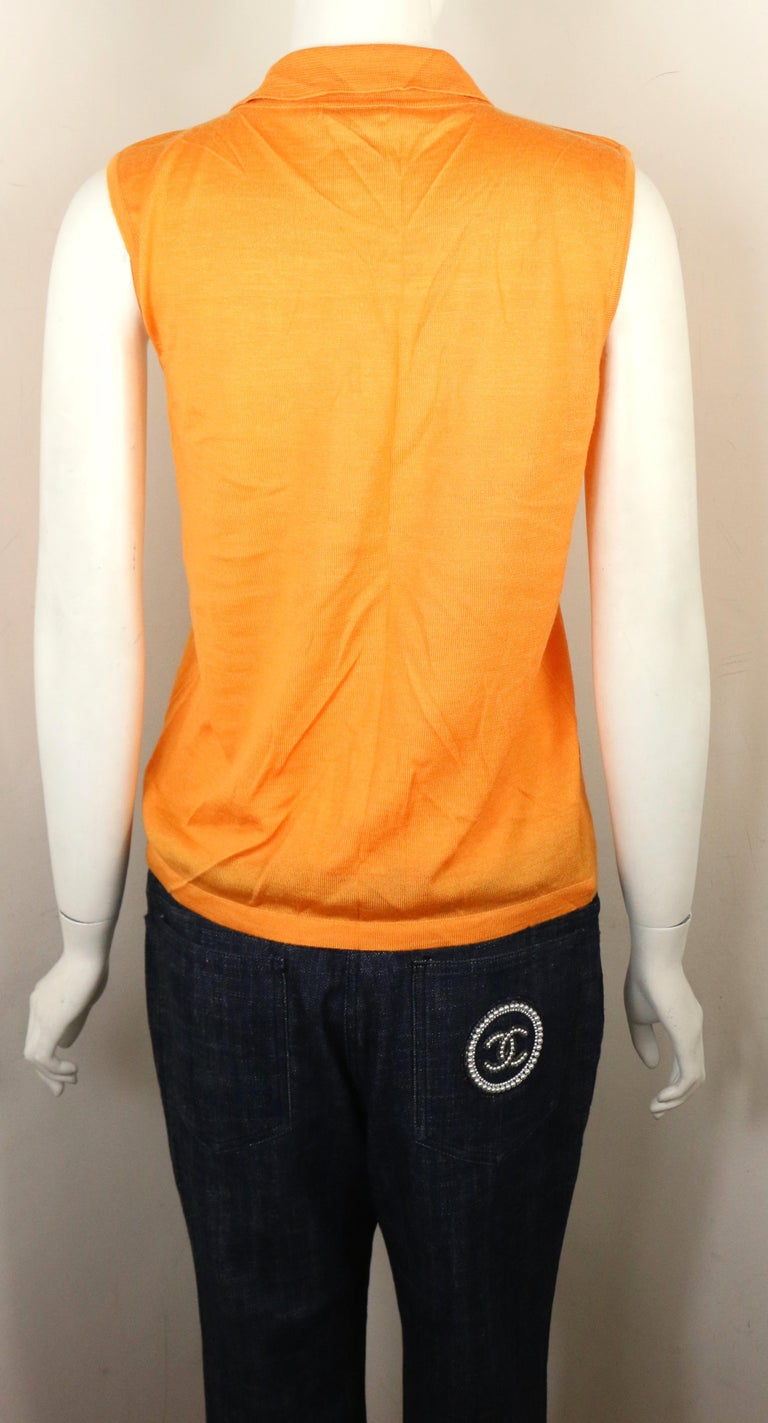 - Chanel orange cashmere and silk sleeveless collar top from the year 2000C collection.   - SIze 42.   - 70% Cashmere, 30% Silk.