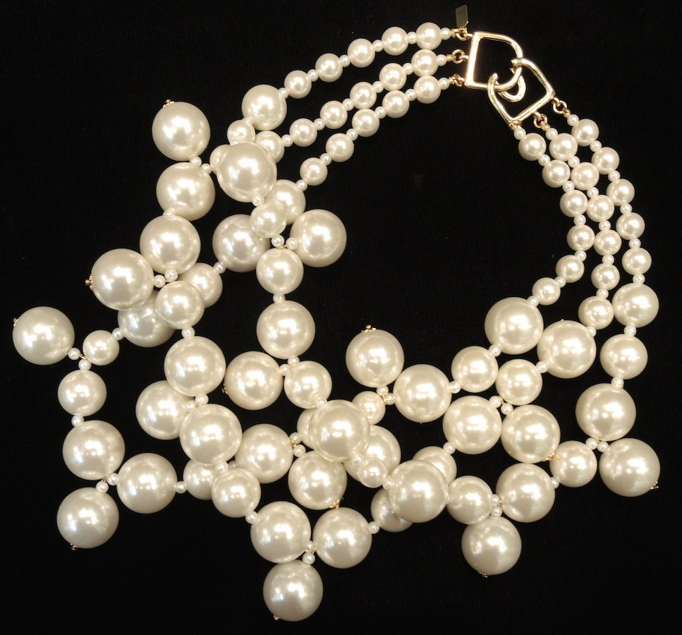 """Yes, I found one bubble necklace in pearl, and I got happy again.  This signed Kenneth Jay Lane necklace features 3 strands of faux pearl resin beads in a silver-tone setting.   In excellent condition, this necklace measures 19 ½"""" with a hook"""