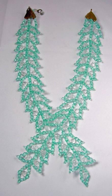 """This vintage 1950's Coppoa e Toppo necklace features bezel cut aquamarine & clear glass beads in a gold-tone setting. This necklace measures 20"""" long with a hook closure; the front bib is 4"""" x 5 1/2"""" wide. In excellent condition, this necklace is"""