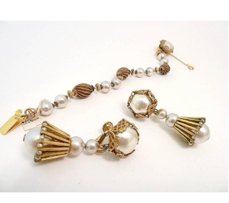 """As you know, it's so very hard to find a bracelet and earrings set by Miriam Haskell that has been kept together, so I was delighted to find these lovelies with faux pearls and etched spacer beads in a gold-tone setting. The bracelet measures 7 ¼"""" x"""