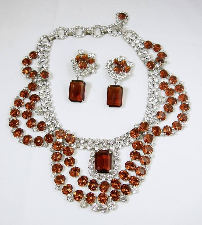 """This One-of-a-Kind set by Robert Sorrell features rich topaz and clear color faceted rhinestones in a silver-tone setting.  The necklace measures 19"""" long with a hook closure and the front drop is, top to bottom, 3 1/4"""".  The clip earrings measure 2"""