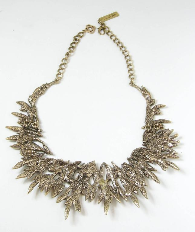 Ethereal and elegant this statement necklace features an intricate motif of cascading Austrian crystals leaves in a mixed silver/gold-tone setting. It is simply dazzling with its fabulous pave crystal leaves. The necklace is very flexible and is