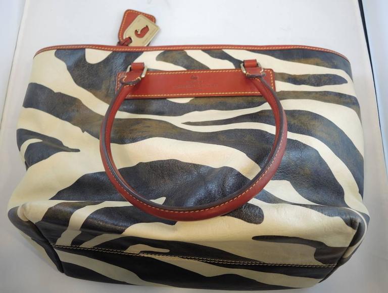 1stdibs Dooney & Bourke Vintage Zebra Florentine Vachetta Leather Handbag, 1970