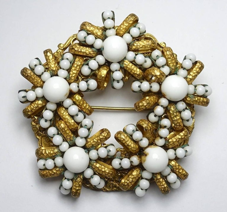 "This vintage 1950's Miriam Haskell brooch features white color beads in a gold tone setting.  This brooch measures 2-1/4"" in diameter with a turn closure, is signed ""Miriam Haskell"" and is in excellent condition"