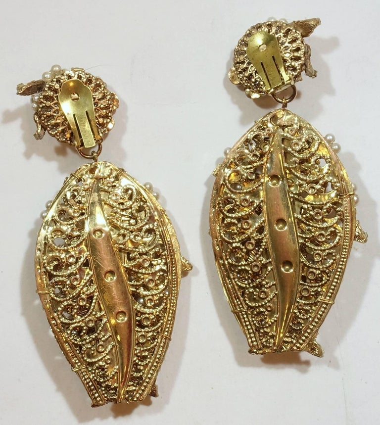 Vintage long faux pearl chandelier earrings at 1stdibs these vintage faux pearl chandelier clip earrings have beautiful faux seed pearls with floral designs and aloadofball