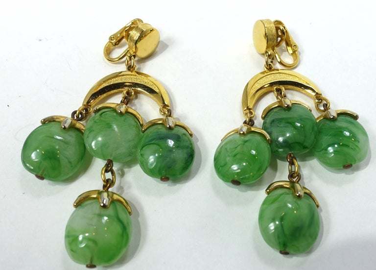 "These vintage signed Trifari earrings have green marbled glass drops in a gold tone setting.  These clip earrings measure 3"" x 1-1/2"" and are signed ""Trifari"". They are in excellent condition."