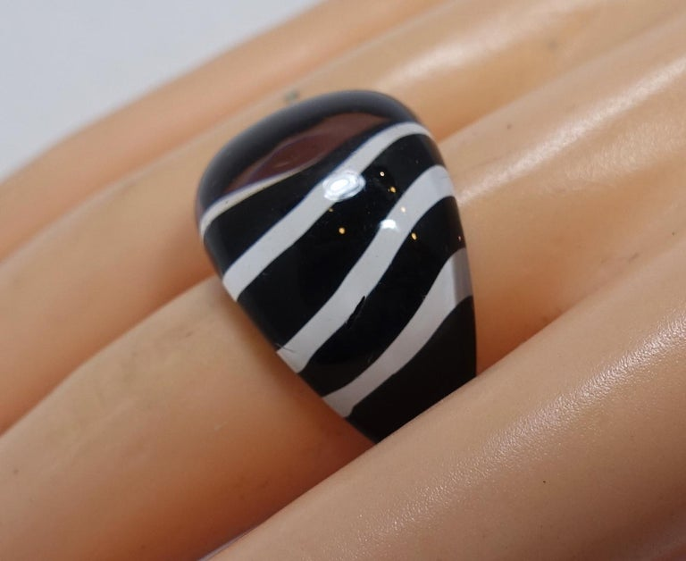 "This vintage 1960s are back in fashion.  This Lucite ring features a black & white stripe design and is a size 8 and measures 3/4"" wide.  It 's in excellent condition."